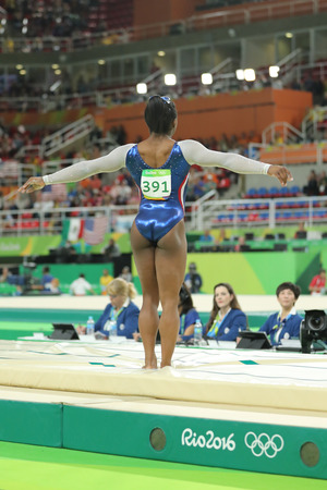 simone: RIO DE JANEIRO, BRAZIL - AUGUST 11, 2016: Olympic champion Simone Biles of United States competing a vault at womens all-around gymnastics at Rio 2016 Olympic Games