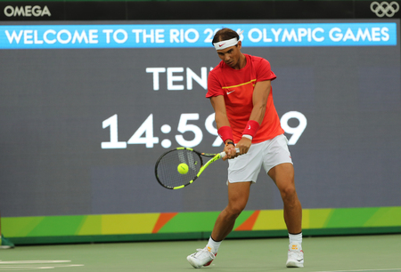 champion spain: RIO DE JANEIRO, BRAZIL - AUGUST 7, 2016: Olympic champion Rafael Nadal of Spain in practice before mens singles first round match of the Rio 2016 Olympic Games at the Olympic Tennis Centre Editorial