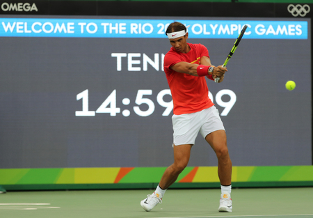 spaniard: RIO DE JANEIRO, BRAZIL - AUGUST 7, 2016: Olympic champion Rafael Nadal of Spain in practice before mens singles first round match of the Rio 2016 Olympic Games at the Olympic Tennis Centre Editorial