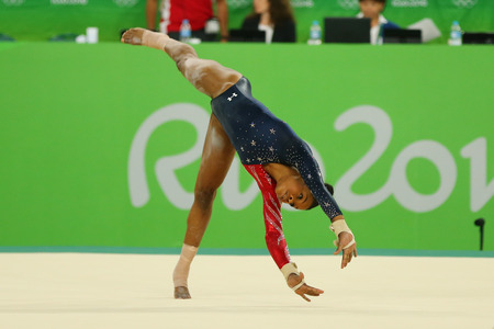 RIO DE JANEIRO, BRAZIL - AUGUST 7, 2016: Olympic champion Gabby Douglas of United States competes on the floor exercise during womens all-around gymnastics qualification at Rio 2016 Olympic Games Editorial