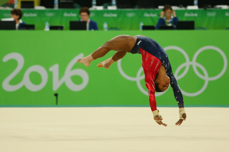 douglas: RIO DE JANEIRO, BRAZIL - AUGUST 7, 2016: Olympic champion Gabby Douglas of United States competes on the floor exercise during womens all-around gymnastics qualification at Rio 2016 Olympic Games Editorial