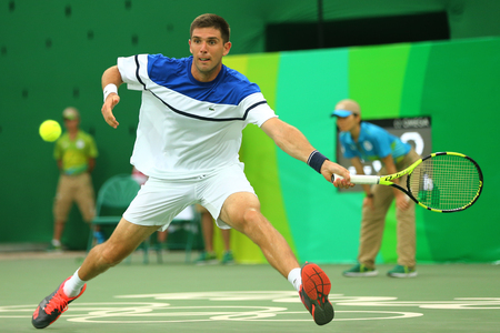 RIO DE JANEIRO, BRAZIL - AUGUST 7, 2016: Tennis player Federico Delbonis of Argentina in action during mens singles first round match of the Rio 2016 Olympic Games at the Olympic Tennis Centre Editorial