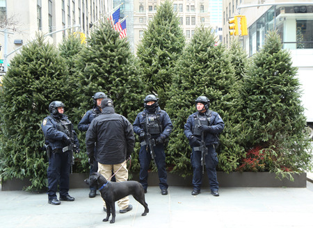 special service agent: NEW YORK - DECEMBER 15, 2016: NYPD counter terrorism officers providing security at Rockefeller Center in midtown Manhattan during Holidays season in New York