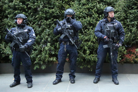 NEW YORK - DECEMBER 15, 2016: NYPD counter terrorism officers providing security at Rockefeller Center in midtown Manhattan during Holidays season in New York