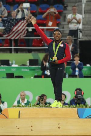 simone: RIO DE JANEIRO, BRAZIL - AUGUST 11, 2016: Womens all-around gymnastics champion at Rio 2016 Olympic Games Simone Biles of Team USA during medal ceremony