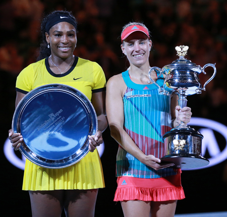MELBOURNE, AUSTRALIA - JANUARY 30, 2016: Australian Open 2016 finalist Serena Williams (L) and Grand Slam champion Angelique Kerber of Germany during trophy presentation after final match in Melbourne