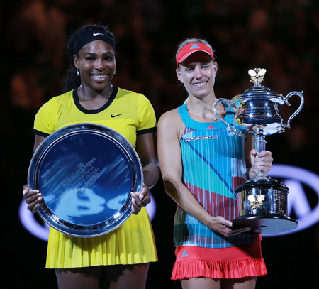 finalist: MELBOURNE, AUSTRALIA - JANUARY 30, 2016: Australian Open 2016 finalist Serena Williams (L) and Grand Slam champion Angelique Kerber of Germany during trophy presentation after final match in Melbourne