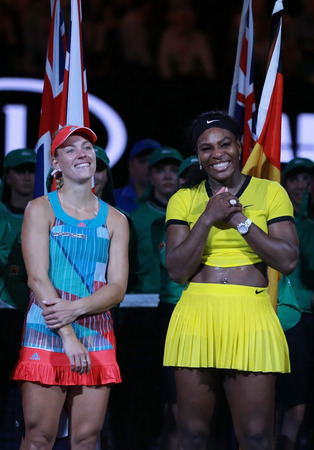 MELBOURNE, AUSTRALIA - JANUARY 30, 2016: Grand Slam champion Angelique Kerber of Germany (L) and Australian Open 2016 finalist Serena Williams during trophy presentation after final match in Melbourne
