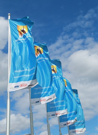 MELBOURNE, AUSTRALIA - JANUARY 31, 2016: Flags with Australian Open logo waving in the wind. The Australian Open is a major tennis tournament held annually in Melbourne, Australia Editorial