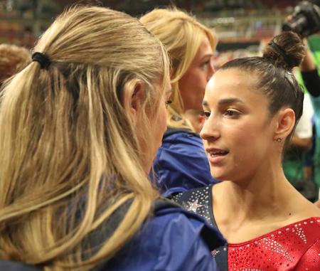 RIO DE JANEIRO, BRAZIL - AUGUST 7, 2016: Olympic champion Aly Raisman of United States with her coach after womens all-around gymnastics competition at Rio 2016 Olympic Games