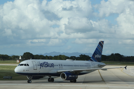 romana: LA ROMANA, DOMINICAN REPUBLIC - JANUARY 4, 2017: Jet Blue plane on tarmac at La Romana International Airport. The Dominican Republic is the most visited destination in the Caribbean