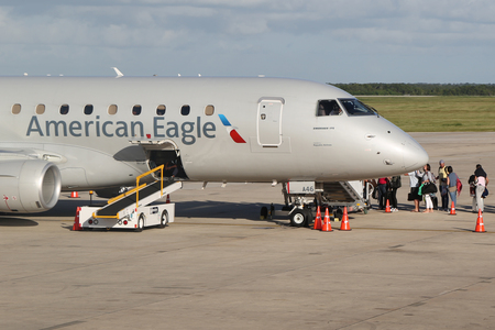 romana: LA ROMANA, DOMINICAN REPUBLIC - JANUARY 4, 2017: American Eagle plane on tarmac at La Romana International Airport. The Dominican Republic is the most visited destination in the Caribbean