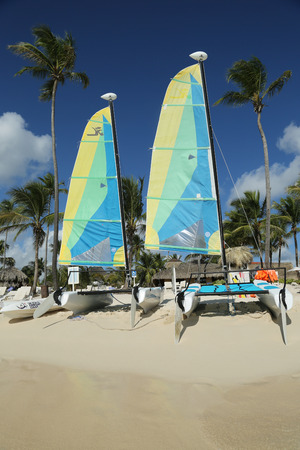 hobie: LA ROMANA, DOMINICAN REPUBLIC - DECEMBER 30, 2016: Hobie Cat catamaran ready for tourists at Playa Bayahibe Beach in La Romana. The Dominican Republic is the most visited destination in the Caribbean