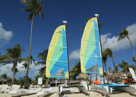 LA ROMANA, DOMINICAN REPUBLIC - DECEMBER 30, 2016: Hobie Cat catamaran ready for tourists at Playa Bayahibe Beach in La Romana. The Dominican Republic is the most visited destination in the Caribbean