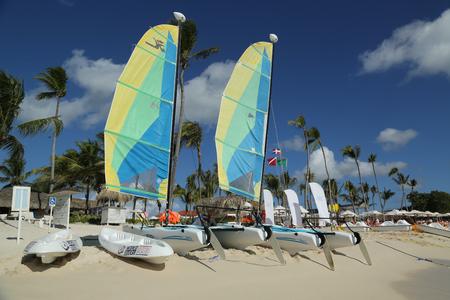 romana: LA ROMANA, DOMINICAN REPUBLIC - DECEMBER 30, 2016: Hobie Cat catamaran ready for tourists at Playa Bayahibe Beach in La Romana. The Dominican Republic is the most visited destination in the Caribbean