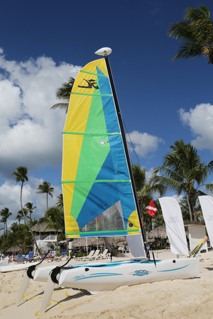 hobie: LA ROMANA, DOMINICAN REPUBLIC - DECEMBER 31, 2016: Hobie Cat catamaran ready for tourists at Playa Bayahibe Beach in La Romana. The Dominican Republic is the most visited destination in the Caribbean Editorial