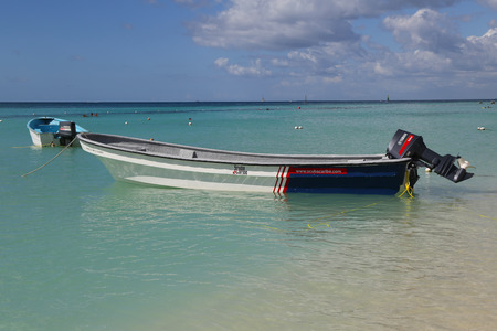 LA ROMANA, DOMINICAN REPUBLIC - DECEMBER 31, 2016: Diving boat at Playa Bayahibe Beach in La Romana, Dominican Republic. The Dominican Republic is the most visited destination in the Caribbean Editorial