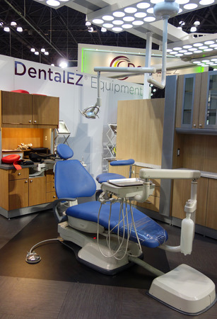 visitador medico: NEW YORK - NOVEMBER 29, 2016: Modern dental unit by DentalEZ on display during Greater New York Dental Meeting at Javits Center. DentalEZ designs and manufactures dental equipment for dental offices