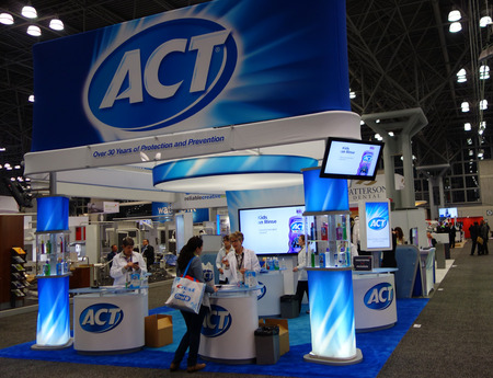 fluoride: NEW YORK - NOVEMBER 29, 2016: ACT booth at the Greater NY Dental Meeting in New York. ACT Anticavity Fluoride Rinses are clinically proven to strengthen teeth and prevent tooth decay Editorial