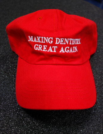 famous industries: NEW YORK - NOVEMBER 29, 2016: Making Dentistry Great Again promotional hat  at the Greater NY Dental Meeting in New York Editorial