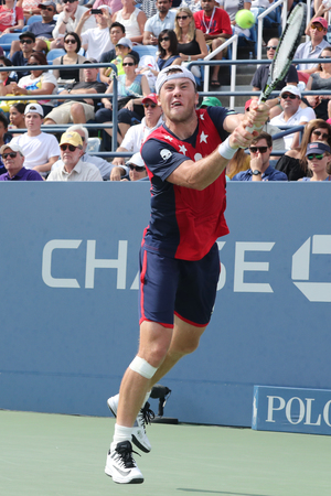 grand hard: NEW YORK - SEPTEMBER 5, 2016: Professional tennis player Illya Marchenko of Ukraine in action during his fourth round match at US Open 2016 at Billie Jean King National Tennis Center in New York