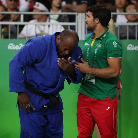 RIO DE JANEIRO, BRAZIL - AUGUST 11, 2016: Portuguese Judoka Jorge Fonseca (in blue) with coach after loss against Lukas Krpalek of Czech Republic men -100 kg match of the Rio 2016 Olympics