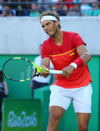 RIO DE JANEIRO, BRAZIL - AUGUST 13, 2016: Olympic champion Rafael Nadal of Spain in action during mens singles semifinal of the Rio 2016 Olympic Games at the Olympic Tennis Centre Editorial