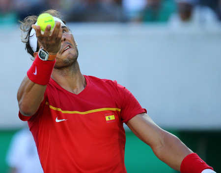 champion spain: RIO DE JANEIRO, BRAZIL - AUGUST 13, 2016: Olympic champion Rafael Nadal of Spain in action during mens singles semifinal of the Rio 2016 Olympic Games at the Olympic Tennis Centre Editorial