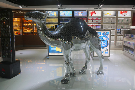 light duty: PRINCESS JULIANA AIRPORT, ST MAARTEN - JUNE 14, 2015: Camel cigarette display at Duty Free shop at Princess Juliana International Airport terminal. Camel is a brand of cigarettes introduced in 1913