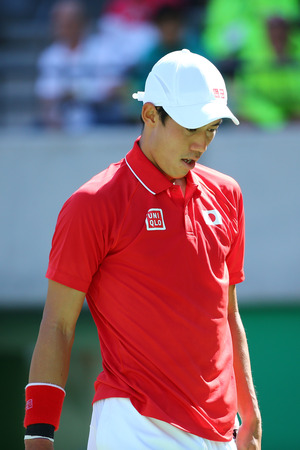 RIO DE JANEIRO, BRAZIL - AUGUST 13, 2016: Professional tennis player Kei Nishikori of Japan in action during his men`s singles semifinal match of the Rio 2016 Olympic Games at the Olympic Tennis Centre
