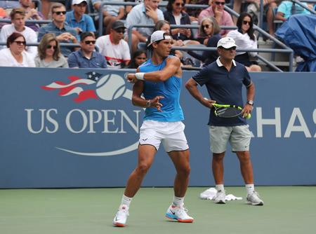 billie: NEW YORK -SEPTEMBER 3, 2016: Fourteen times Grand Slam Champion Rafael Nadal of Spain with his coach Tony Nadal practices for US Open 2016 at Billie Jean King National Tennis Center in New York