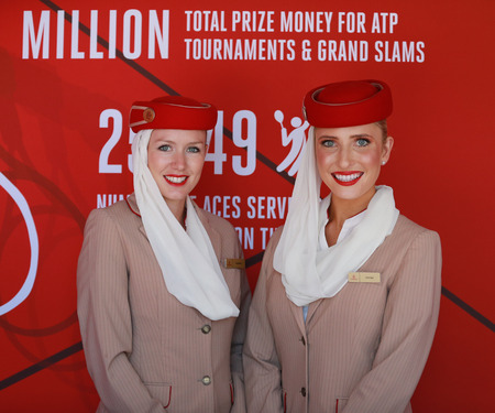 us open: NEW YORK - AUGUST 29, 2016: Emirates Airlines flight attendants at the Emirates Airlines booth at the Billie Jean King National Tennis Center during US Open 2016 in New York