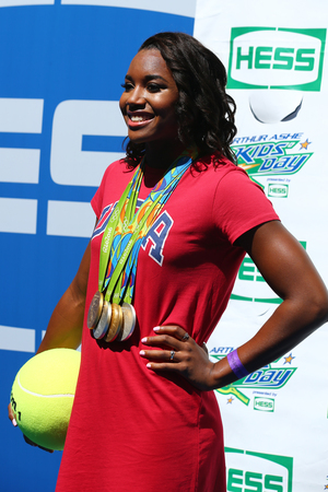 grand slam: NEW YORK - AUGUST 27, 2016: Rio 2016 Olympics Champion swimmer Simone Manuel participates at Arthur Ashe Kids Day 2016 at Billie Jean King National Tennis Center in New York