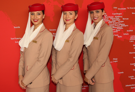 us open: NEW YORK - SEPTEMBER 11, 2016: Emirates Airlines flight attendants at he Emirates Airlines booth at the Billie Jean King National Tennis Center during US Open 2016 in New York Editorial