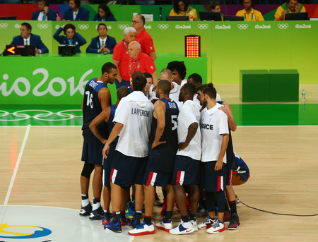 RIO DE JANEIRO, BRAZIL - AUGUST 10, 2016: Team France celebrates victory after group A basketball match of the Rio 2016 Olympic Games against team Serbia at Carioca Arena 1