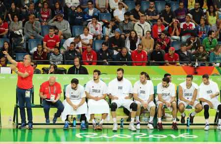 RIO DE JANEIRO, BRAZIL - AUGUST 10, 2016: Team Serbia in action during group A basketball match of the Rio 2016 Olympic Games against team France at Carioca Arena 1