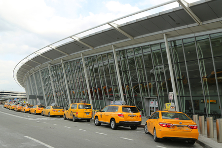 NEW YORK- FEBRUARY 2, 2017: NYC taxi at Delta Airline Terminal 4 at JFK International Airport in New York. JFK is one of the biggest airports in the world with 4 runways and 8 terminals Editorial