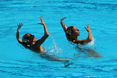 RIO DE JANEIRO, BRAZIL - AUGUST 14, 2016: Ona Carbonell and Gemma Mengual of Spain compete during synchronized swimming duets free routine preliminary of the Rio 2016 Olympic Games