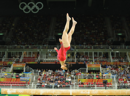 RIO DE JANEIRO, BRAZIL - AUGUST 11, 2016: Olympic champion Aly Raisman of United States competes on the balance beam at women's all-around gymnastics at Rio 2016 Olympic Games Imagens - 71005185