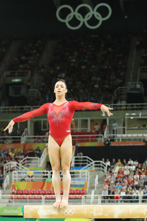 the olympic rings: RIO DE JANEIRO, BRAZIL - AUGUST 11, 2016: Olympic champion Aly Raisman of United States competes on the balance beam at womens all-around gymnastics at Rio 2016 Olympic Games