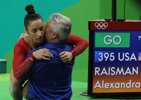 the olympic rings: RIO DE JANEIRO, BRAZIL - AUGUST 11, 2016:Coach Mihai Brestyan and Olympic champion Aly Raisman of USA during competition on the balance beam at womens all-around gymnastics at Rio 2016 Olympic Games Editorial
