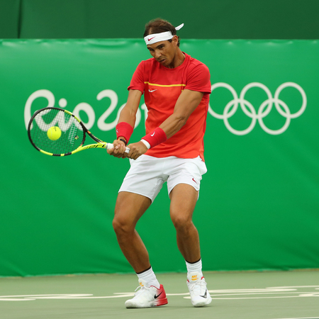 RIO DE JANEIRO, BRAZIL - AUGUST 7, 2016: Olympic champion Rafael Nadal of Spain in action during mens singles first round match of the Rio 2016 Olympic Games at the Olympic Tennis Centre