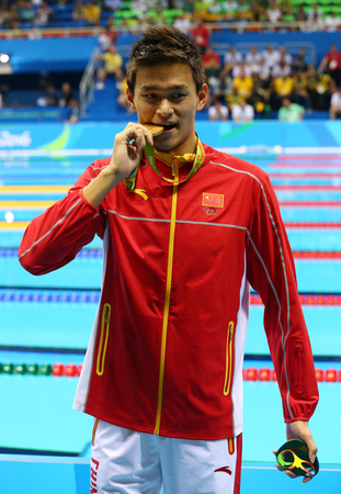 RIO DE JANEIRO, BRAZIL - AUGUST 8, 2016: Olympic champion Yang Sun of China during medal ceremony after Mens 200m freestyle of the Rio 2016 Olympics at Olympic Aquatic Stadium Editorial
