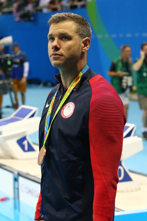 RIO DE JANEIRO, BRAZIL - AUGUST 8, 2016: Bronze medalist David Plummer of United States during medal ceremony after Mens 100m backstroke of the Rio 2016 Olympics at Olympic Aquatic Stadium