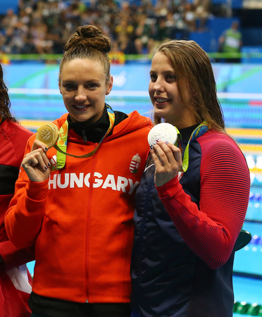 RIO DE JANEIRO, BRAZIL - AUGUST 8, 2016: Olympic Champion Katinka Hosszu of Hungary (L) and medalist Kathleen Baker of USA during medal ceremony after Womens 100m backstroke of the Rio 2016 Olympics