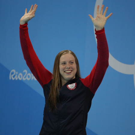 RIO DE JANEIRO, BRAZIL - AUGUST 8, 2016: Olympic Champion Lilly King of the United States celebrates victory after Womens 100m Breaststroke Final of the Rio 2016 Olympic Games Editorial