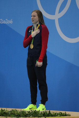 olympic ring: RIO DE JANEIRO, BRAZIL - AUGUST 8, 2016: Olympic Champion Lilly King of the United States celebrates victory after Womens 100m Breaststroke Final of the Rio 2016 Olympic Games Editorial