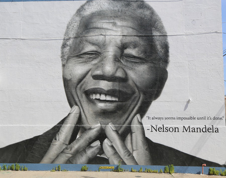 NEW YORK - JUNE 21, 2014: Nelson Mandela mural in Williamsburg section in Brooklyn. Williamsburg is an influential hub of current indie rock, hipster culture, and the local art community