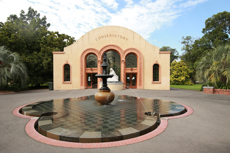 conservatory: MELBOURNE, AUSTRALIA - JANUARY 27, 2016: The Conservatory in the Fitzroy Gardens, Melbourne. Built in classic Spanish Mission style in 1930, The Conservatory exhibits five floral displays each year.