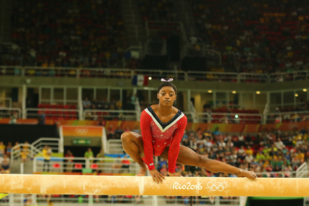 olympic ring: RIO DE JANEIRO, BRAZIL AUGUST 15, 2016: Olympic champion Simone Biles of United States competes at the final on the balance beam womens artistic gymnastics at Rio 2016 Olympic Games Editorial